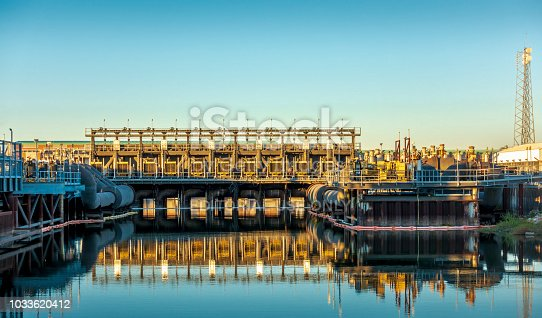 New Orleans, USA - Nov 28, 2017: Afternoon view of the 17th Street Canal Pump Station as viewed from the road. This structure forms part of the city's flood control mechanism.