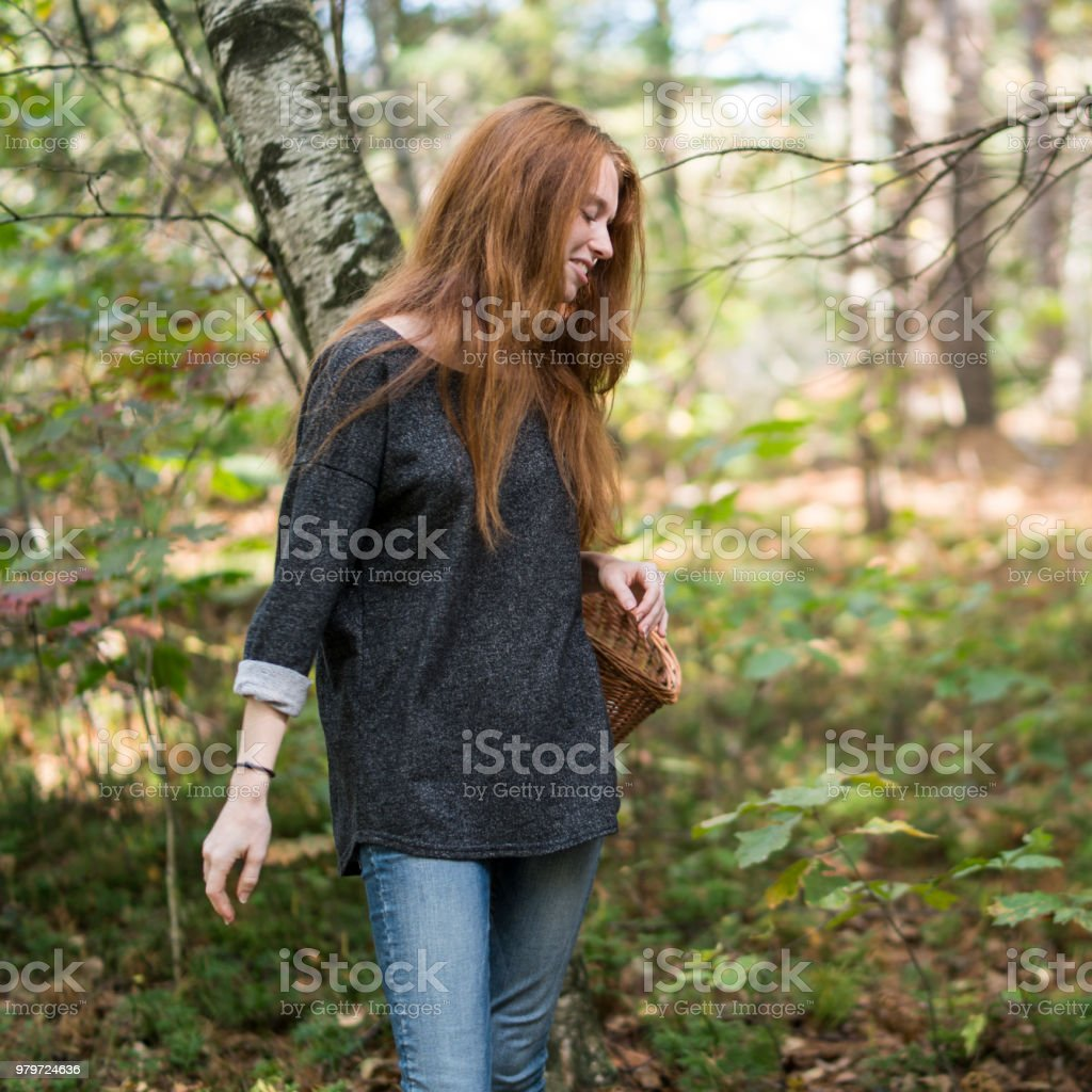 17-years-old teenager girl hiking in the forest - foto stock