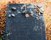 Charlestown, Nevis, St Kitts and Nevis: Nevis Jewish Cemetery - 18th century grave and stones left by visitors -  Hebrew inscription -  Nevis Sephardic community no longer exists