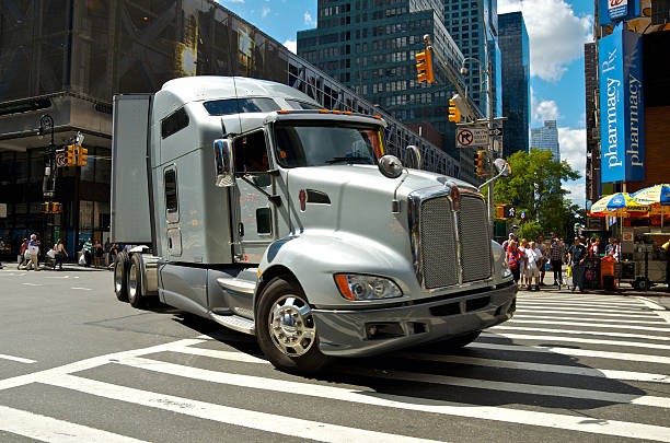 18-Wheeler Tractor-Trailer truck turning onto 8th Ave, Manhattan, NYC stock photo