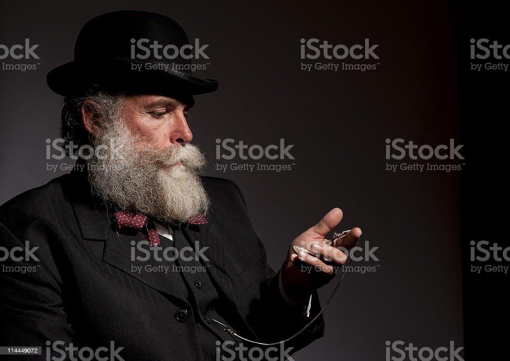 1920s era man checking his pocket watch stock photo