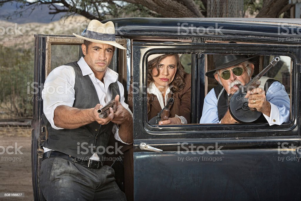 1920s Gangsters Aiming Weapons stock photo