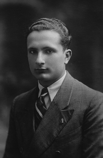 1930s 1940s 1950s Studio shot of a young elegant suit dressed italian man