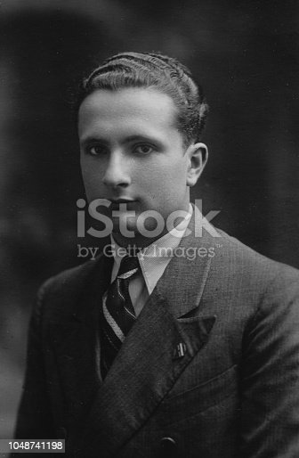 1930s 1940s 1950s Studio shot of a young elegant suit dressed italian man