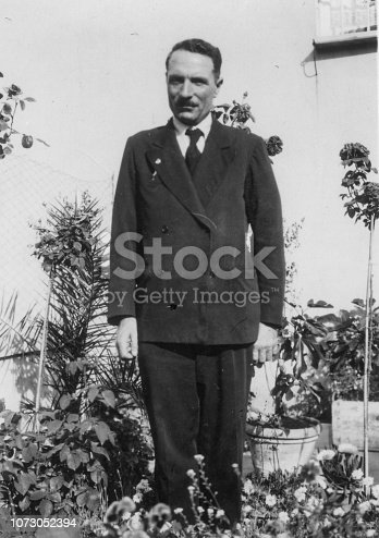 1930s 1940s 1950s outdoor shot of a young elegant suit dressed italian man