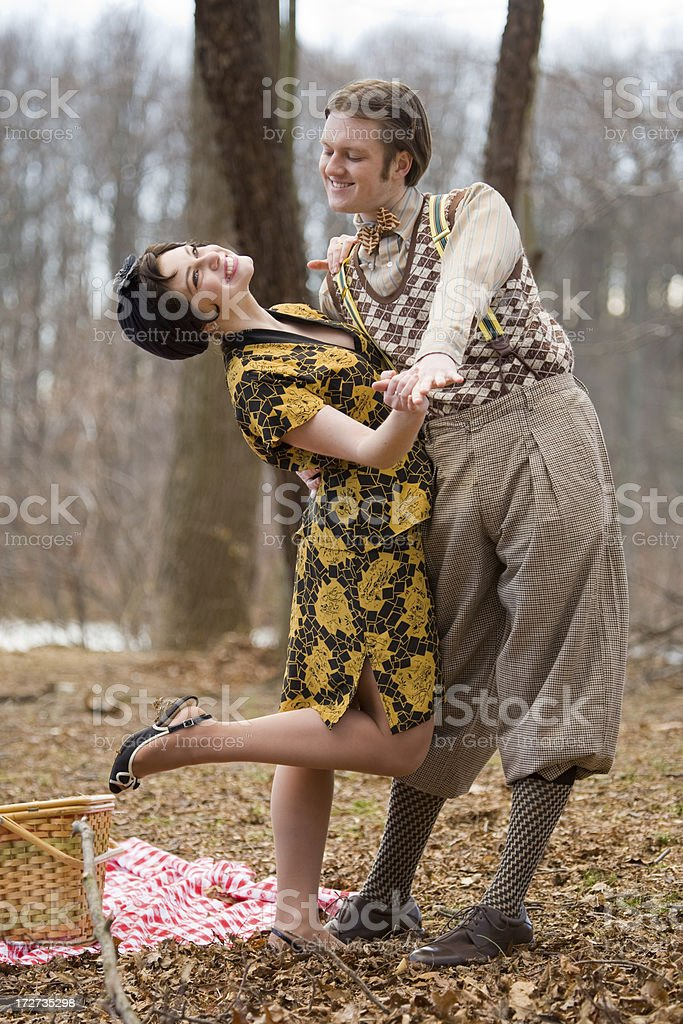 1920s style couple dancing at a park royalty-free stock photo