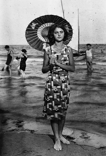istock 1920s young woman portrait at the beach, Italy. 1048741280