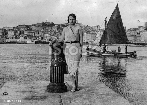 istock 1920s young woman portrait at the beach, Italy. 1048741714
