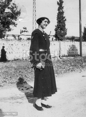istock 1930s. Florence Tuscany Italy young woman portrait in the home meadow 1079017862