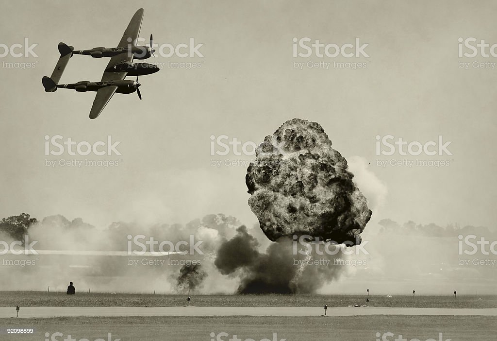 1930s photo showing Aerial bombardment by twin engine plane stock photo