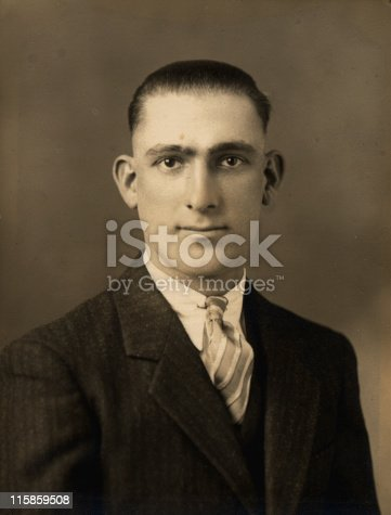 Formal portrait of a man taken in 1930s.