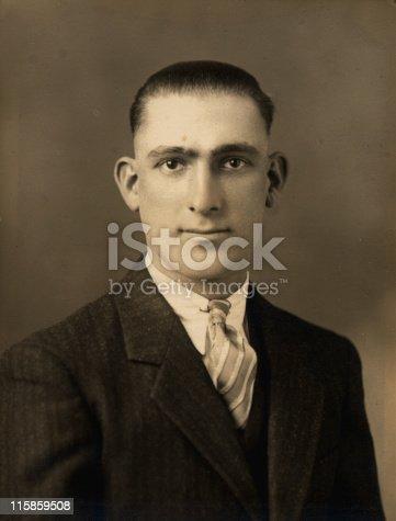Formal portrait of a man taken in 1930s.