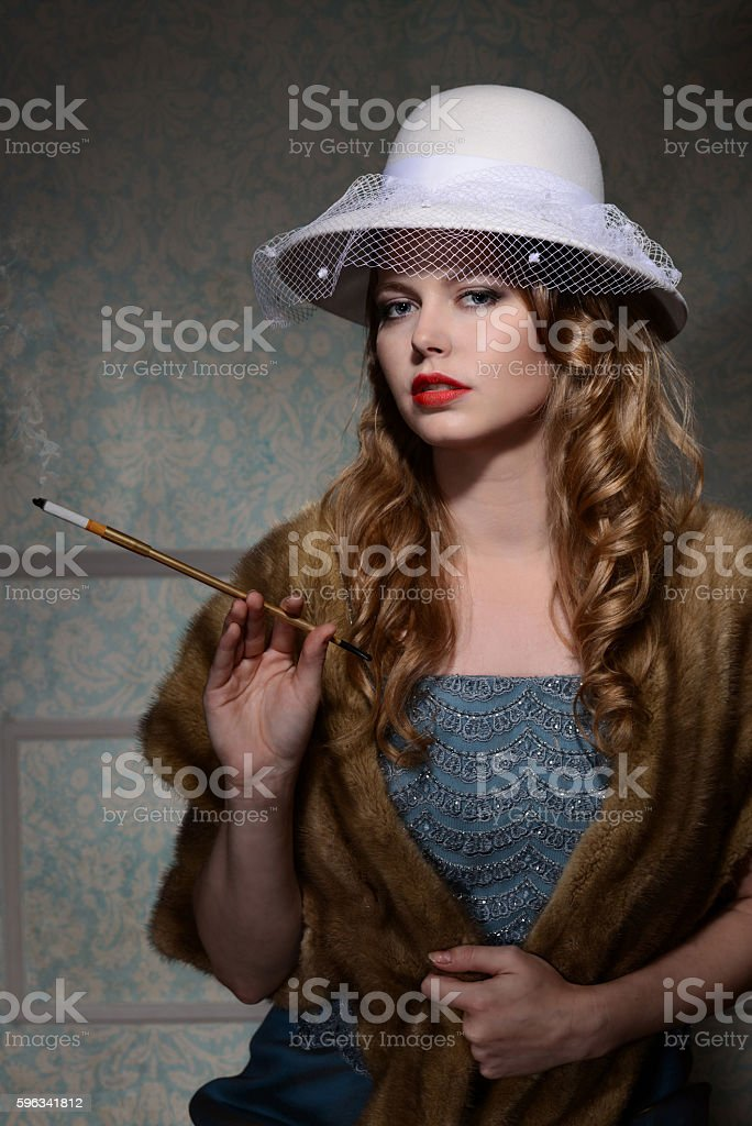 1940s fashion woman with cigarette royalty-free stock photo