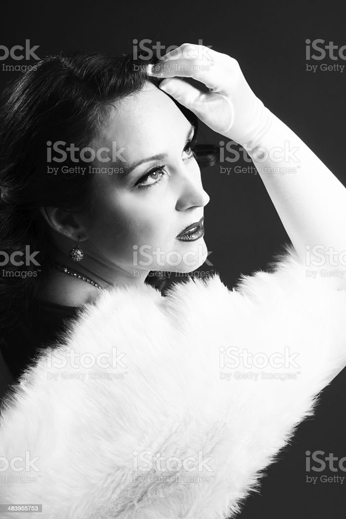 1940s movie glamour style portrait of woman touching forehead. stock photo