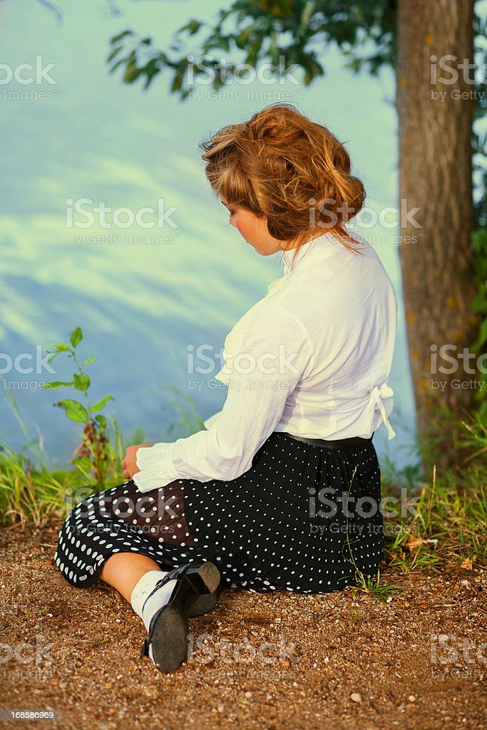 1940s style.  Woman in park. stock photo