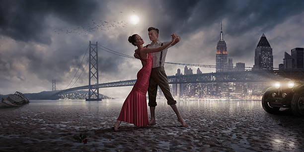 1940s vintage dancers on a moonlit beach near city lights - romantic moon stock photos and pictures