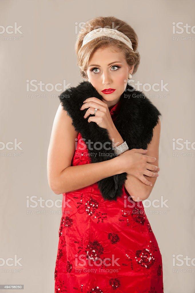 1950s Blonde woman wearing fur wrap stock photo