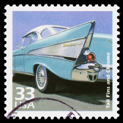 Sacramento, California, USA - March 28, 2011: A 1999 USA postage stamp with an illustration of the chrome and tail fins styling of a 1957 Chevrolet Bel Air 2-door hardtop. The stamp was illustrated by Dean Ellis, with art direction by Howard Paine.