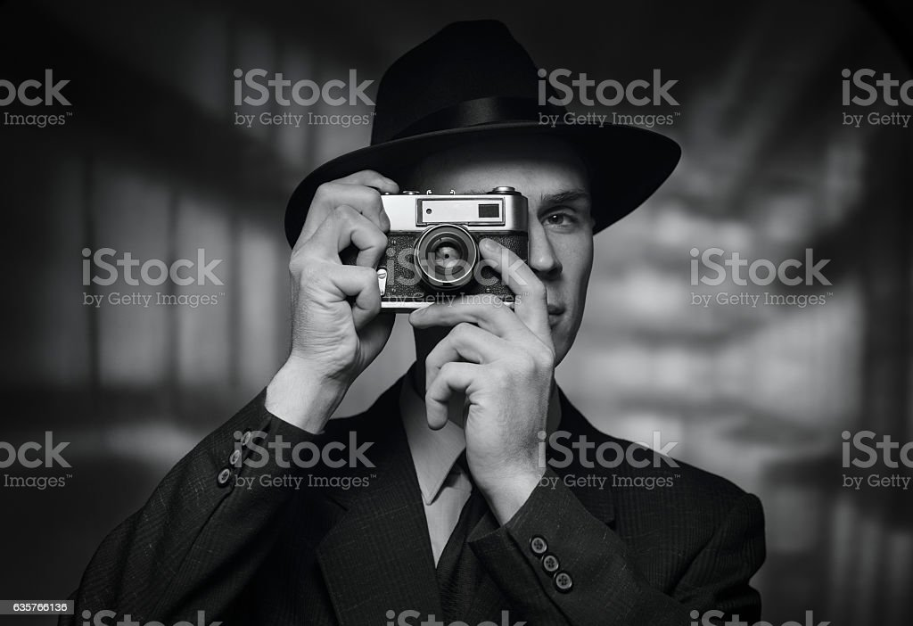 1950s man in hat taking a picture stock photo
