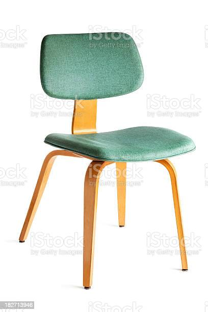 A mid-century modern dining or side chair featuring turquoise blue vinyl cushions with woven texture and blond plywood bent wood structure. The 1950s or 1960s comfortable, beautiful, and stylish design is popular for retro period home decor. Seating furniture shown at three-quarter view, cut out and isolated on white background.