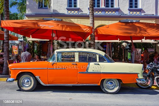 Vintage 1950s Chevy Bel Air is parked on Ocean Drive in South Beach, Miami, Florida on a sunny day.