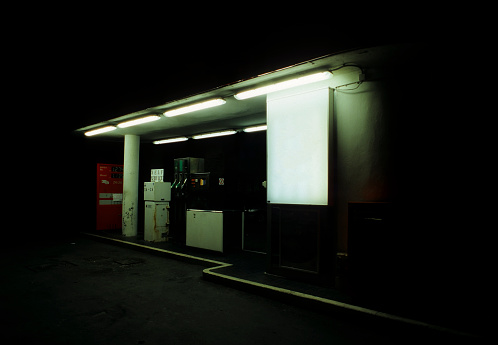 Gas station at night.