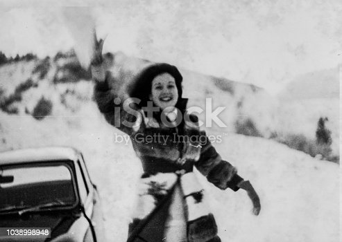 1970s Outdoor snow weather young woman in black and white having fun with snow in the Tuscany hills around Florence