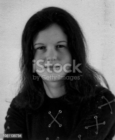 1970s indoor studio portrait of a young woman in black and white taken with 35mm film