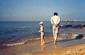 istock 1980s China Little Girl and Father Old Photo of Real Life 1307006329