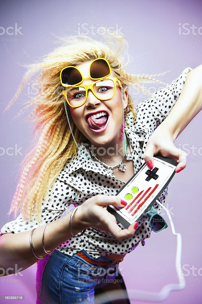 1980s woman with gamin console royalty-free stock photo