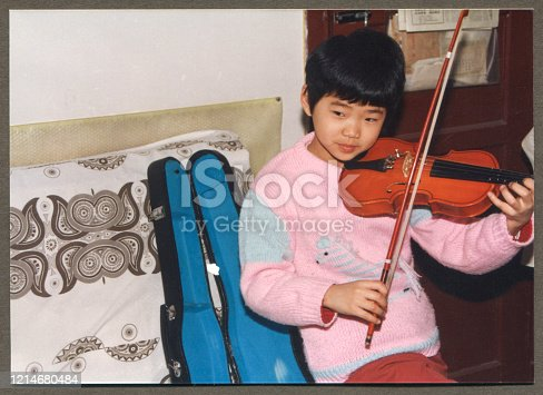 1990s Chinese Little girl practicing violin