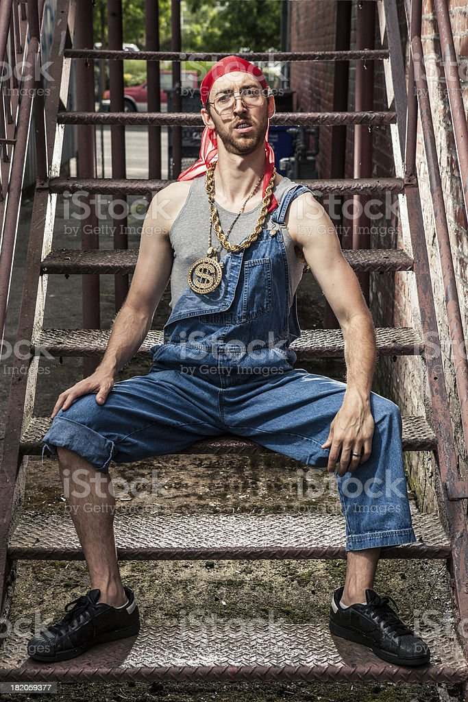1990s Hip-Hop Goofy Nerd Guy with Bling in Dark Alley royalty-free stock photo