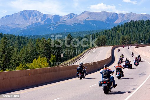 Woodland Park, Colorado, USA - August 20, 2011: Motorcycle parade on westbound highway 24 at the base of Pikes Peak Colorado to kick off the 19th annual Salute to American Veterans Rally.