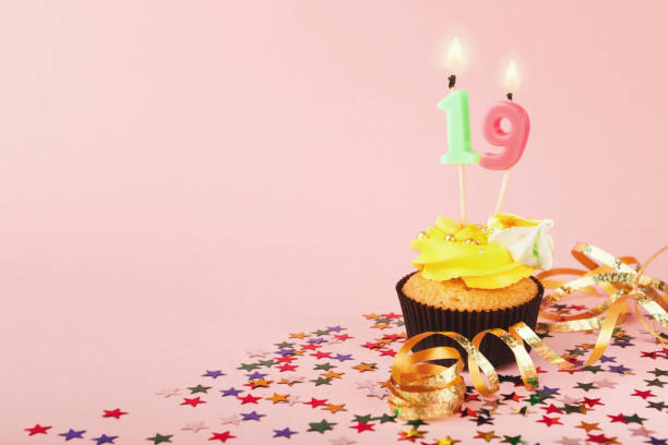 19th birthday cupcake with candle and sprinkles - number 19 stock photos and pictures