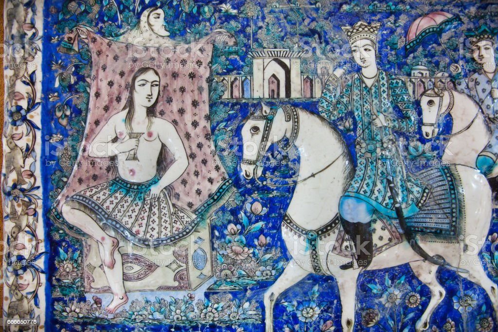 19th century ceramic tiles with couple of lovers in garden, Iran. stock photo