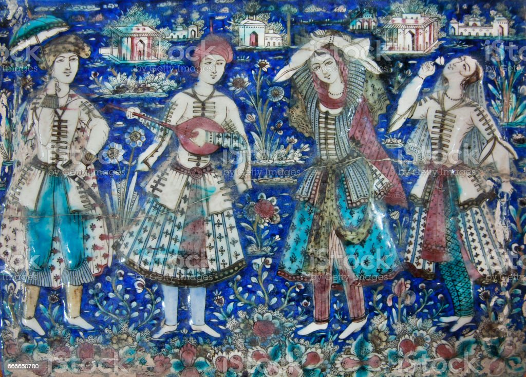 19th century ceramic tiles with musician and dacers in garden, Iran. Outstanding example of Islamic culture stock photo