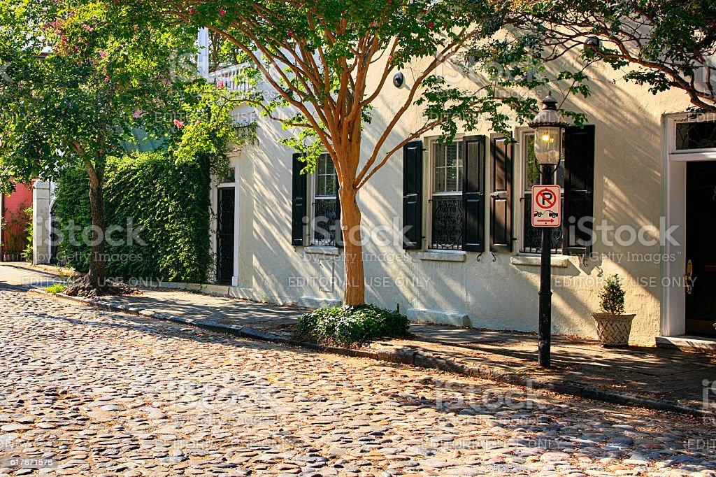 19th century Chalmers' cobblestone Charles street in historic Charleston, SC stock photo