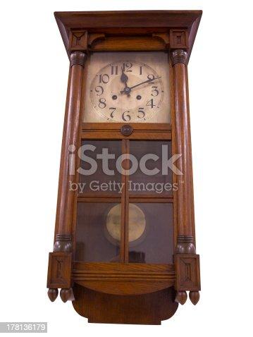 istock 19th Century old pendulum wooden clock isolated on white 178136179
