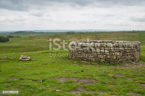 istock 19th Century well at Housesteads Roman Fort, Hadrian's Wall, Northumberland 845268528