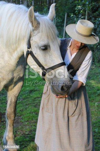 istock 19th Century Woman With Percheron Horse 183034636