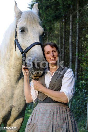 istock 19th Century Woman With Percheron Horse 183034802