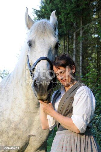 istock 19th Century Woman With Percheron Horse 183035751