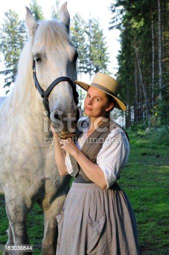 istock 19th Century Woman With Percheron Horse 183036844