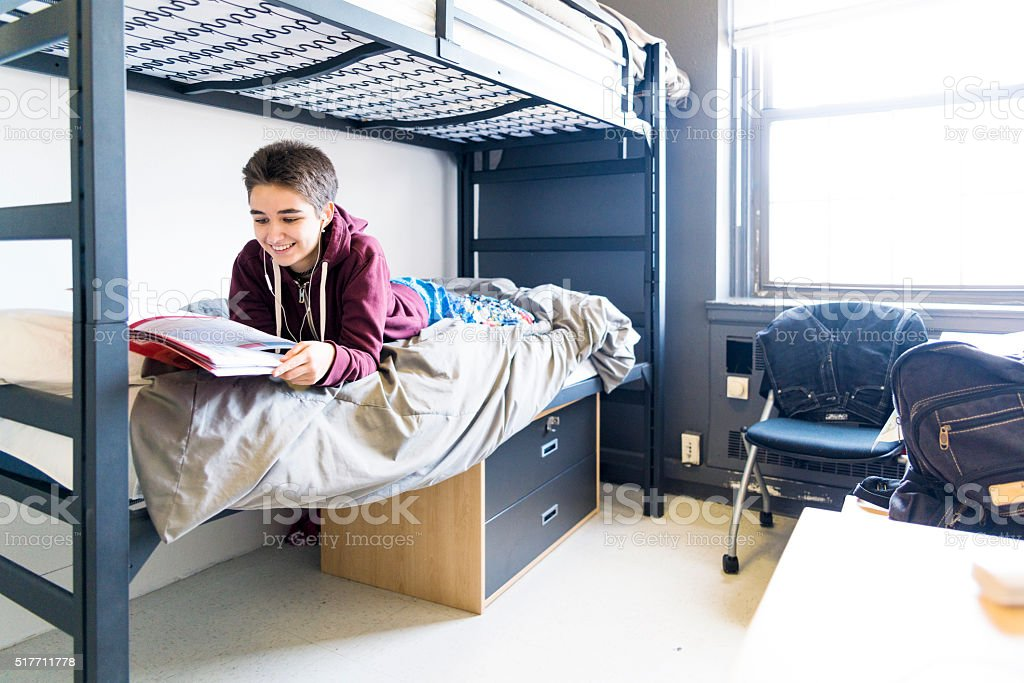 19-years-old student girl in the campus's dormitory  room stock photo