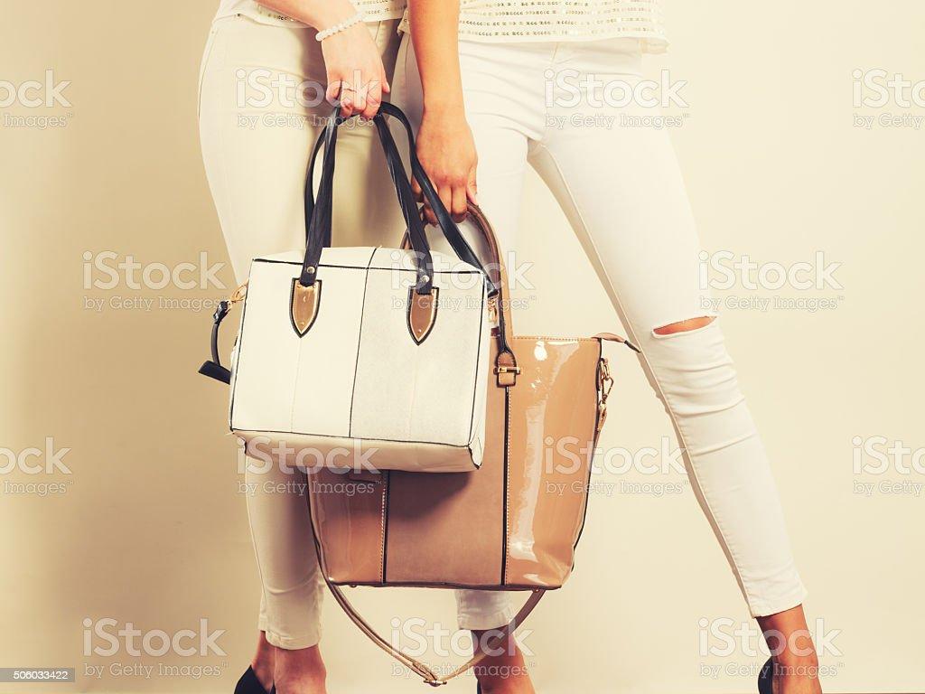1Fashionable girls with bags handbags. stock photo