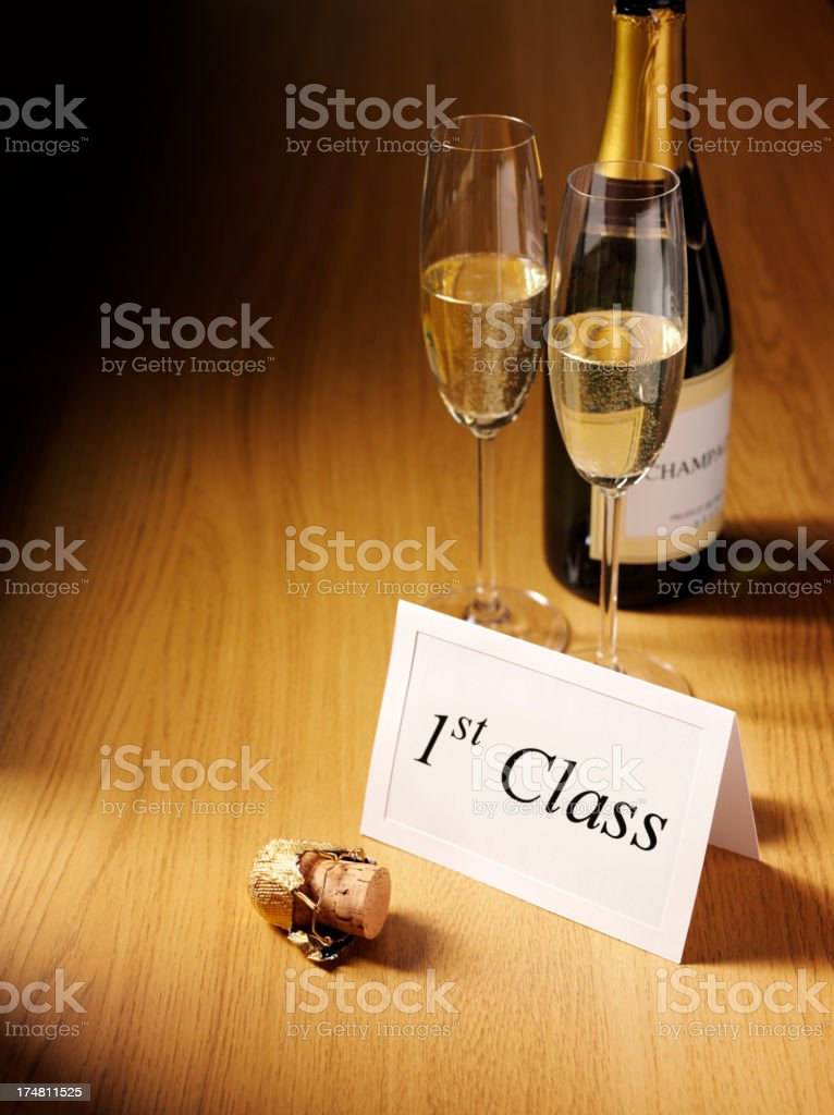 1st Class Card with Champagne Glasses on a Desk royalty-free stock photo