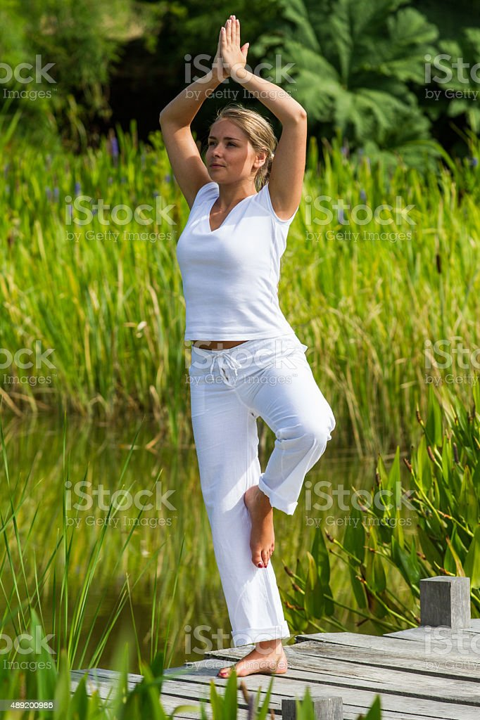 20s blond girl revitalizing herself,water environment stock photo