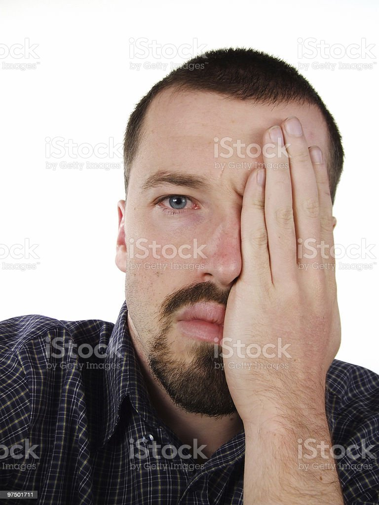 20s male face with one eye covered royalty-free stock photo