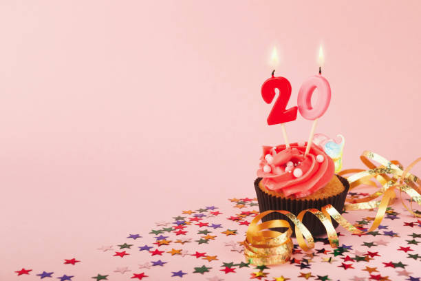 20th birthday cupcake with candle and sprinkles - number 20 stock photos and pictures