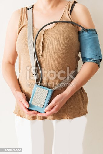 istock 24-hour blood pressure monitoring for women with ambulatory blood pressure monitoring equipment 1186528888